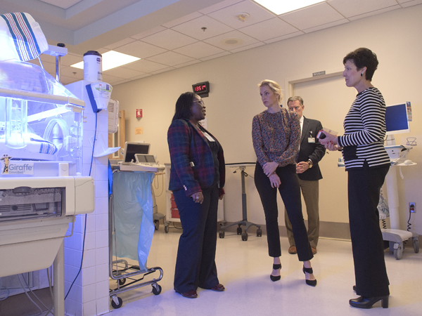 Dr. Mobolaji Famuyide, left, Dr. Rick Barr and Dr. Renate Savich tell comedian and author Ali Wentworth, center, about the neonatal intensive care unit at Wiser Hospital for Women and Infants.