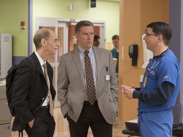 Dreyer, left, talks with Dr. Rick Barr, Suzan B. Thames Professor and chair of pediatrics at UMMC, and Dr. Benjamin Dillard, right, professor of pediatric emergency medicine, while touring the pediatric emergency department Thursday.