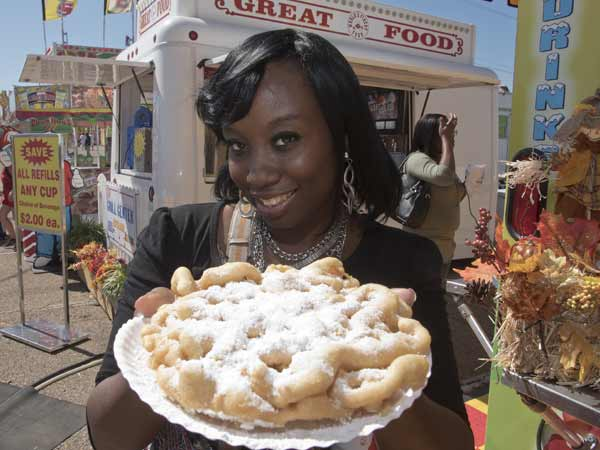Latasha McGee of Pearl plans to share her funnel cake with a friend.