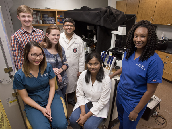 The Janorkar lab, front row from left: Quynh Chau Nguyen, D2; Gurumurthy; Kendra Clark, D3;  back row from left: Jared Cobb, Ph.D student; Sarah Fitzgerald, Ph.D. student; Janorkar.