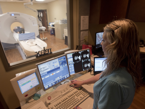 Registered nuclear medicine technologist Mary Beth Croisdale begins the PET scan of Hankins.