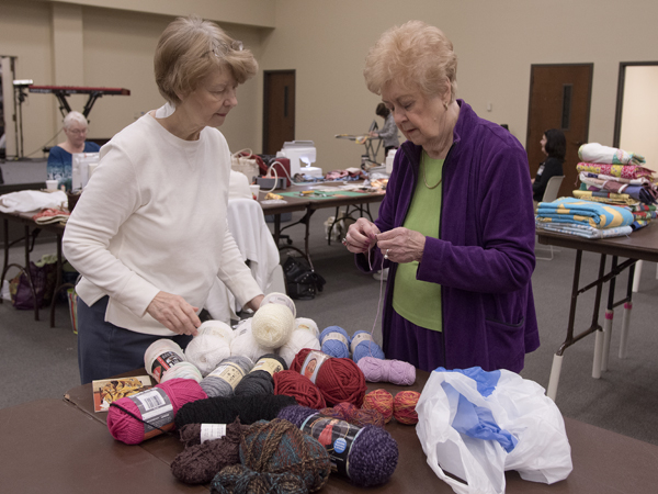 Karen Hill, left, and Helen Goldman look over yarns to hand-tie prayer quilts for Batson Children's Hospital patients during a sewing day at Christ United Methodist Church in Jackson.