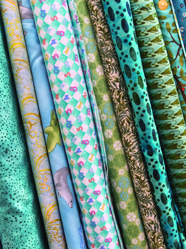 Bolts of fabric in the Susannah Stitchers' storage room sit waiting to be cut and sewn into place.