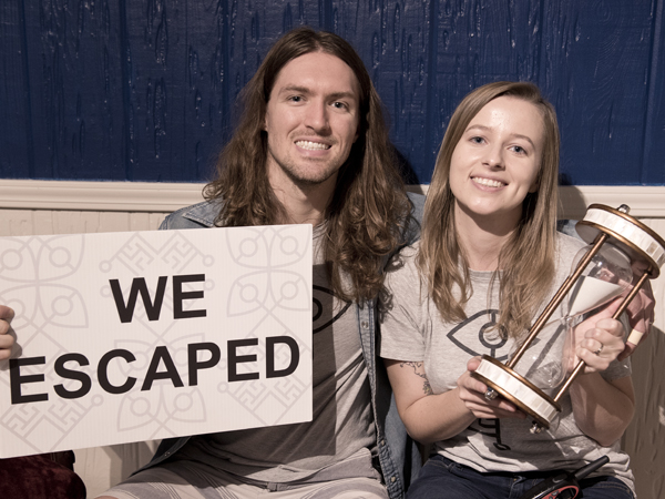Sistrunk and his wife Paulina, right, spent their honeymoon escaping rooms across the U.S.