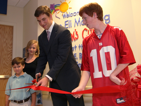 In 2009, Eli cuts the ribbon for the Eli Manning Children's Clinics with help from Batson Children's Hospital patients, from left, Cameron Smyly, Aubree Jordan and Taylor Gibson.