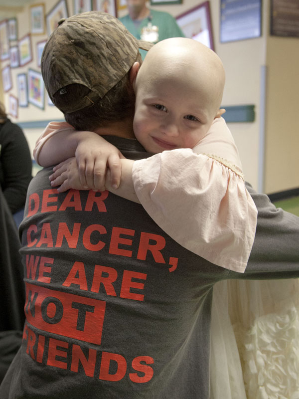 Magnolia Jones gets a hug from her brother, Grayson DeVito, in the lobby of Batson Children's Hospital during Radiothon 2015.