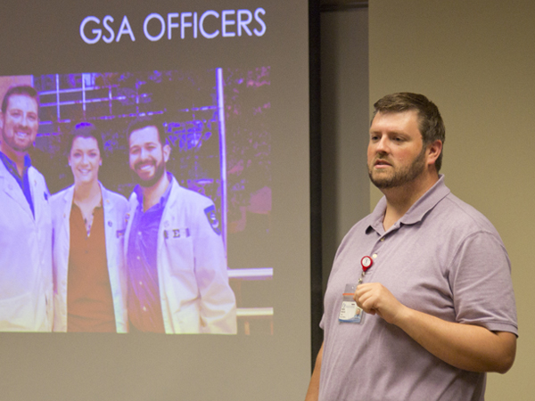 Third-year medical student Brent Necaise, co-president of GSA, explains the organization's goals, during the Aug. 26 alliance meeting.