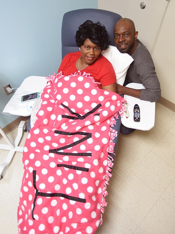 Anitrus Robinson and her husband, Joey, go Pink for Tink as she receives chemotherapy at the UMMC Cancer Institute Outpatient Clinic.