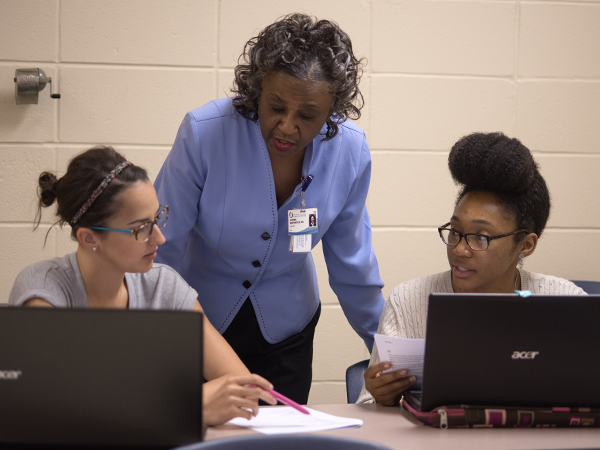Northington said she sets high standards for her students because nurses have the responsibility of another person's life in their hands. She is pictured here with students in the accelerated nursing class, Taylor-Alice WcWllams, left, and Courtney Swhoops.