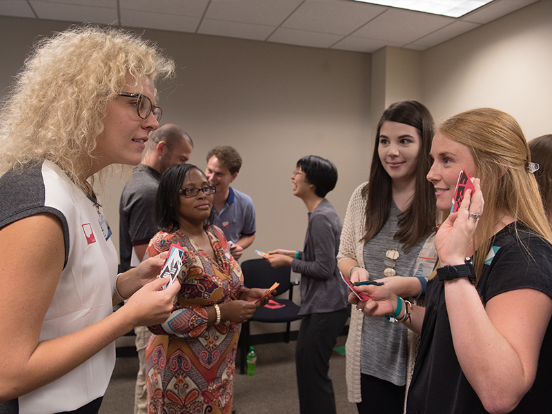 First-year dental students, from left, Kalin McCate Roach and Jaleesa Dandridge work with their medical student counterparts, Alexis Mason and Anna Britt, in a training exercise known as Bafa Bafa, which is  designed to increase awareness of cultural differences.