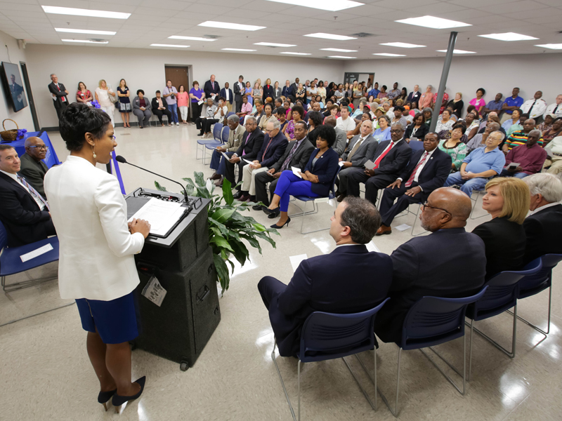Dr. Tonya Moore, administrator of community health services for UMMC's Center for Telehealth, welcomes a standing-room only crowd to the ribbon cutting for the Community Care Clinic.