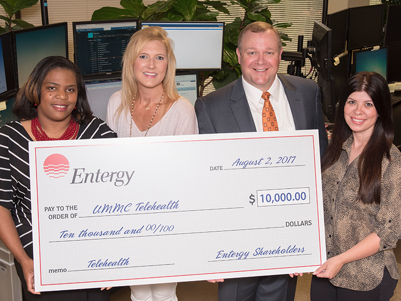 Taking part in a check presentation for Entergy's $10,000 donation to the Center for Telehealth at the University of Mississippi Medical Center are Durant native Tearsanee Davis, the Center's director of clinical and advanced practice operations; Entergy representative Valarie Mabry; UMMC Center for Telehealth executive director Michael Adcock; and Tara Craft, Center for Telehealth services administrator.