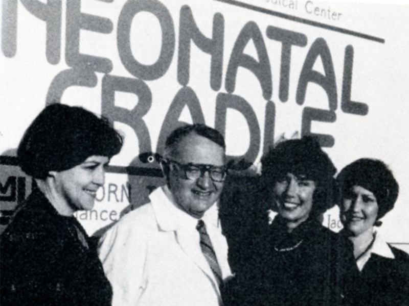 On hand for the Neonatal Cradle's christening party in 1979 were Dr. Norman C. Nelson, UMMC vice chancellor for health affairs and Junior League of Jackson members, from left, Helen Dalehite, Alabel Liles and Judy Porter.