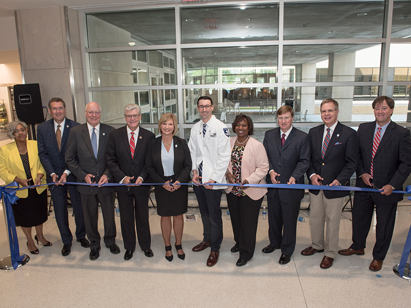 Cutting a ceremonial ribbon at the dedication of the new School of Medicine are, from left, UMMC chaplain Doris Whitaker, U.S. Rep. Gregg Harper, Dr. James Keeton, Gov. Phil Bryant, Dr. LouAnn Woodward, Johnny Lippincott, Dr. Loretta Jackson-Williams, Lt. Gov. Tate Reeves, Chancellor Jeffrey Vitter and Dr. Ford Dye.