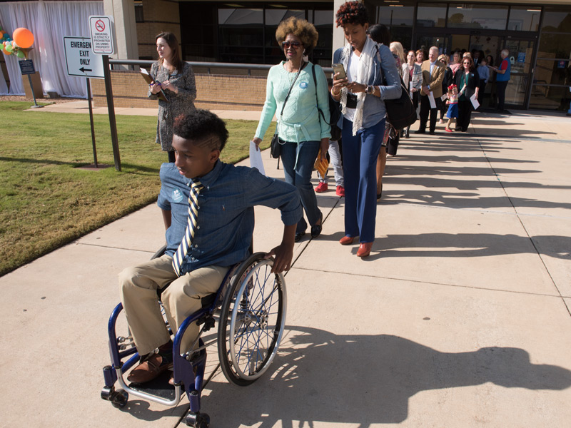 Batson Children's Hospital patient K.J. Fields leads a procession of patients and family members at the groundbreaking.