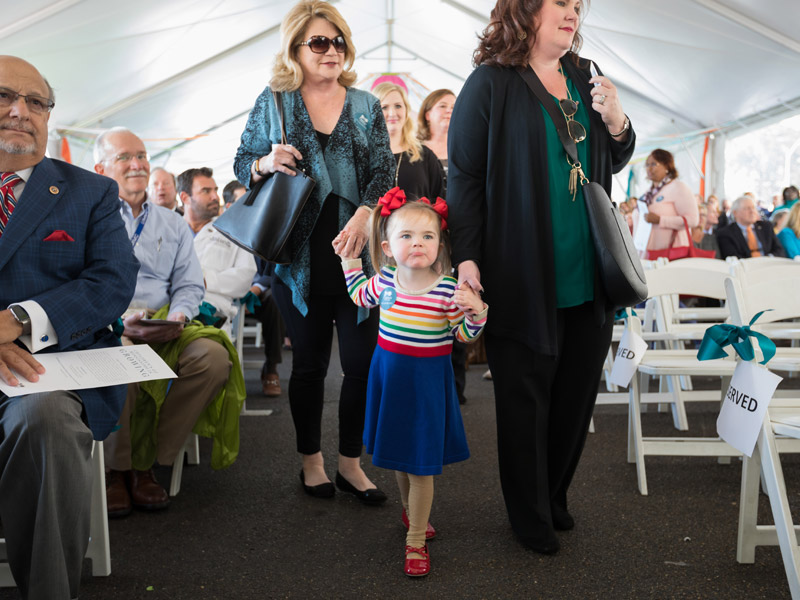 Batson Children's Hospital patient Addison Hamm and family members take a seat at the groundbreaking ceremony.