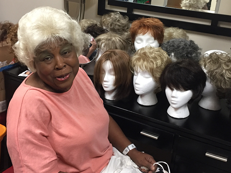 Terethia Goulding models her newly coiffed wig in the UMMC Cancer Institute Patient Resource Center.
