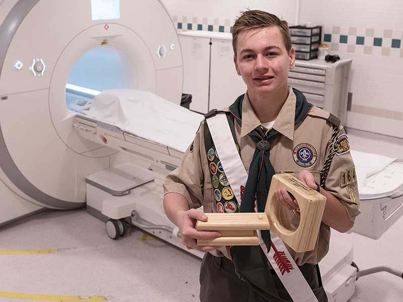 Robert Tickner of Madison shows his Eagle Scout project, a model MRI machine aimed at easing young patients' fears of imaging.