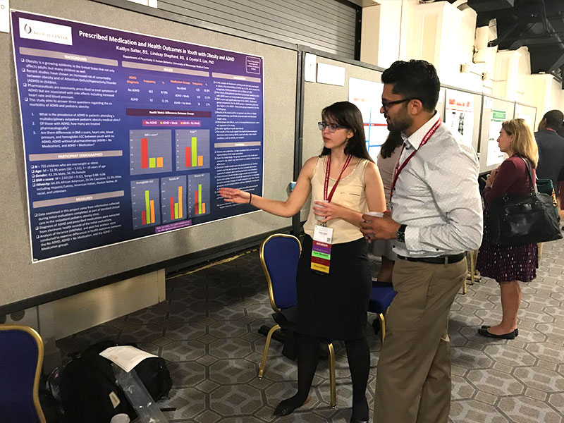 At the 2017 AACAP Annual Meeting, Salter describes her findings to Dr. Raymond Chankalal, a fellow at the University of Buffalo's Department of Psychiatry.