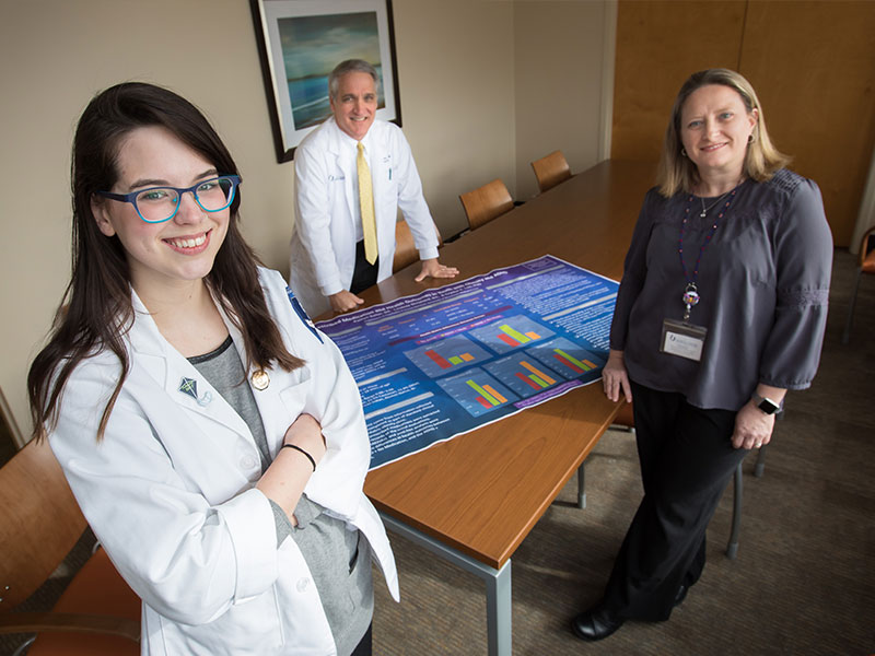 Kaitlyn Salter, foreground, winner of a fellowship award from the American Academy of Child and Adolescent Psychiatry, said she received invaluable help from her mentors, including Dr. Philip Merideth, center, and Dr. Crystal Lim.