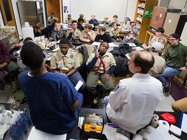 Sanders and Case explain where and how to take a pulse to Jackson-area Boy Scouts.