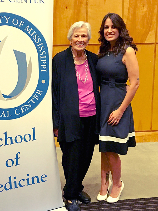 In this July 21, 2016, file photo UMMC nursing legend Bebe Richardson, left, congratulates her granddaughter Lewis, who was one of more than two dozen senior medical students inducted into the Gold Humanism Honor Society.