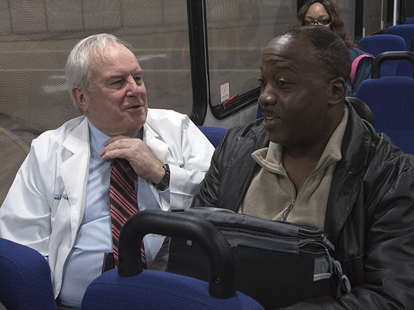 Henderson chats with IT support analyst Walter Allen on a UMMC shuttle bus.