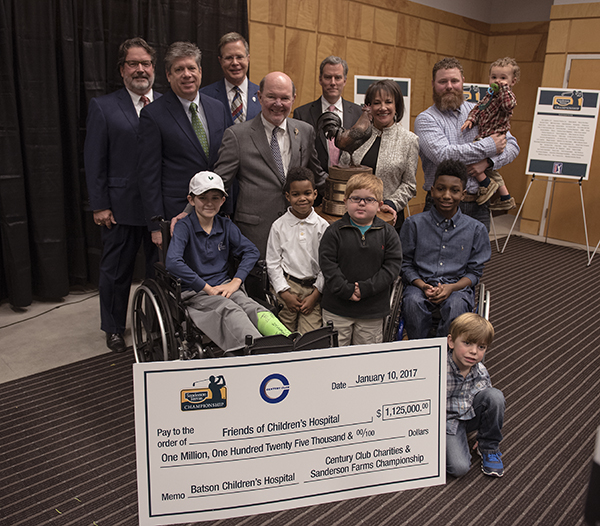 Smiling with the $1.125 million donation to Friends of Children's Hospital are Batson Children's Hospital patients, front, from left, Felton Walker, De'Nahri Middleton, Blake Stone, K.J. Fields, Tucker Jones (kneeling), and Jamie Beck, held by dad Carson Beck. Looking on are, from left, Marks, Jent, Vitter, Sanderson, and Ray.