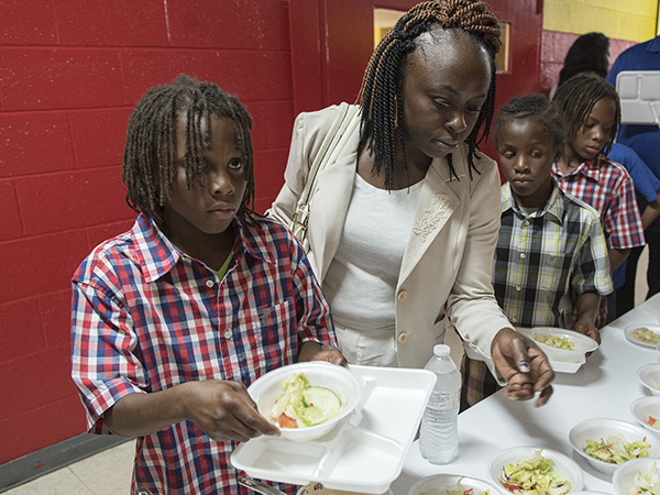 Jonestown mom of five Otibehia Allen, 32, and three of her five children -- twins Javarious, left, and Jamarious Gilliam, right, and son George Gilliam -- choose salads during a lunch at Madison Shannon Palmer High in Marks.