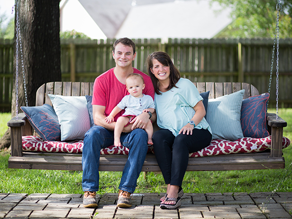 Miles Backtrom's woodworking creations range in size from small to large, like this pergola and swing that he enjoys with his wife Laura and their son Bennett at their home in Madison. Daughter Lottie Leigh was born on June 30, not many days after this photo was taken.