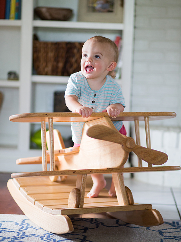 Bennett Backtrom, 15 months, plays on the airplane rocker that his dad, Miles Backtrom, built.