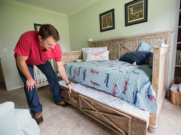 Backstrom shows a daybed he built for his son's room that includes a hide-a-way trundle.