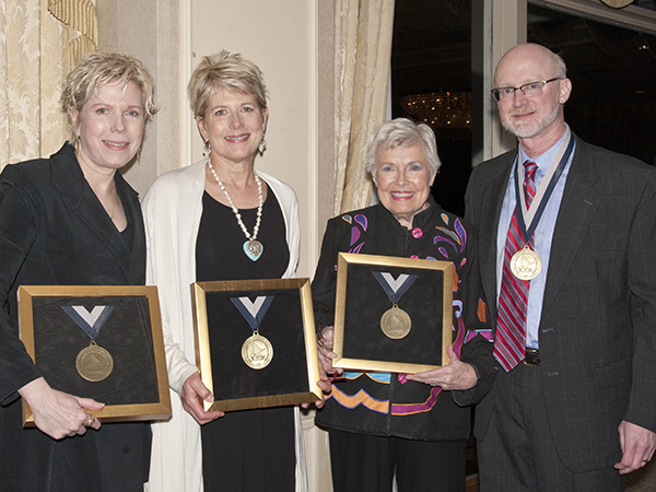 Dr. Tom Mosley, right, recipient of the Dudley and Robbie Hughes Distinguished MIND Center Chair, and Hughes family members, from left, Cindy Hughes Meehl, Vikki Hughes and their mother, Robbie Hughes, receive medallions during the April 14, 2015 ceremony to announce the awarding of the new chair.