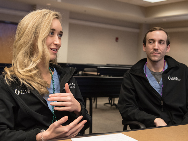 FrancoMed member Laurel Lackey, left, describes how she used her knowledge of French during a medical emergency in Paris, as Colton Lee listens in.