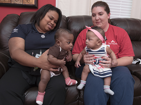 Brittney Course, left, and Shelly Fowler hold Course's twins, Carter and Carleigh Jae.