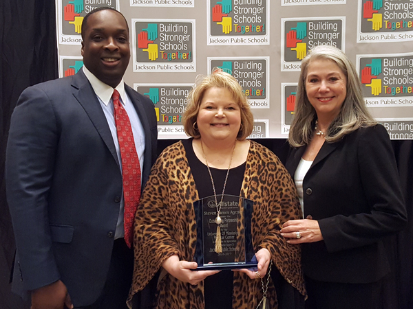 Tammy Dempsey, center, Office for Community Engagement and Service Learning director, and Dr. Janet Harris, professor of nursing and associate dean for practice and community engagement, receive the Steven James Allstate Award on behalf of UMMC from James, an Allstate agent.