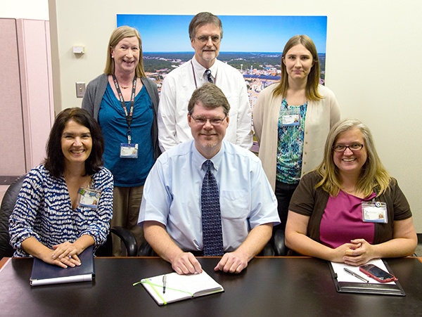 Public Affairs' staff writers and their respective primary areas of responsibility include, front row from left, Annie Oeth, pediatrics; Bruce Coleman, Medical Center operations and administration; and Alana Bowman, Schools of Dentistry, Nursing and Health Related Professions; and back row from left, Ruth Cummins, clinical operations, emergency services and telehealth; Gary Pettus, School of Medicine; and Karen Bascom, research and School of Graduate Studies in the Health Sciences.