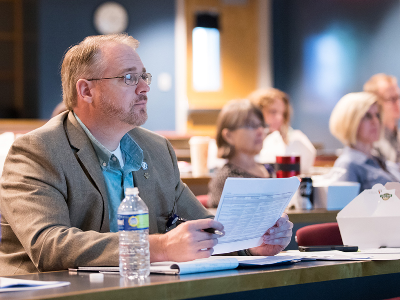 Dr. Mark Gray, left, associate professor of radiologic sciences and associate dean for academic affairs, and other School of Health Related Professions faculty attend the SHRP P&T Educational Forum Sept. 22.