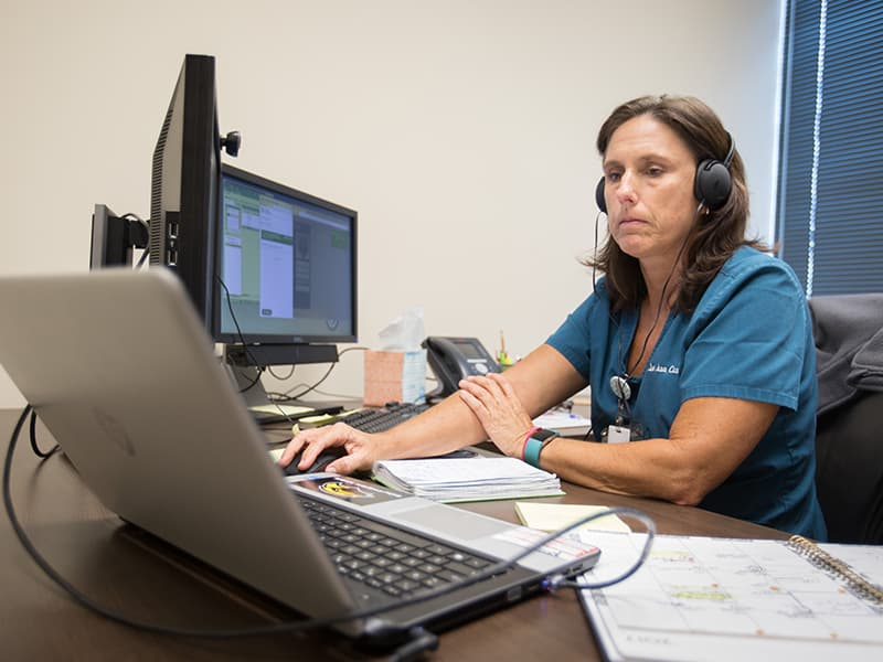 Nurse practitioner Lea Ann Coxwell cares for a patient via live, interactive video from the Ridgeland offices of UMMC's Center for Telehealth.