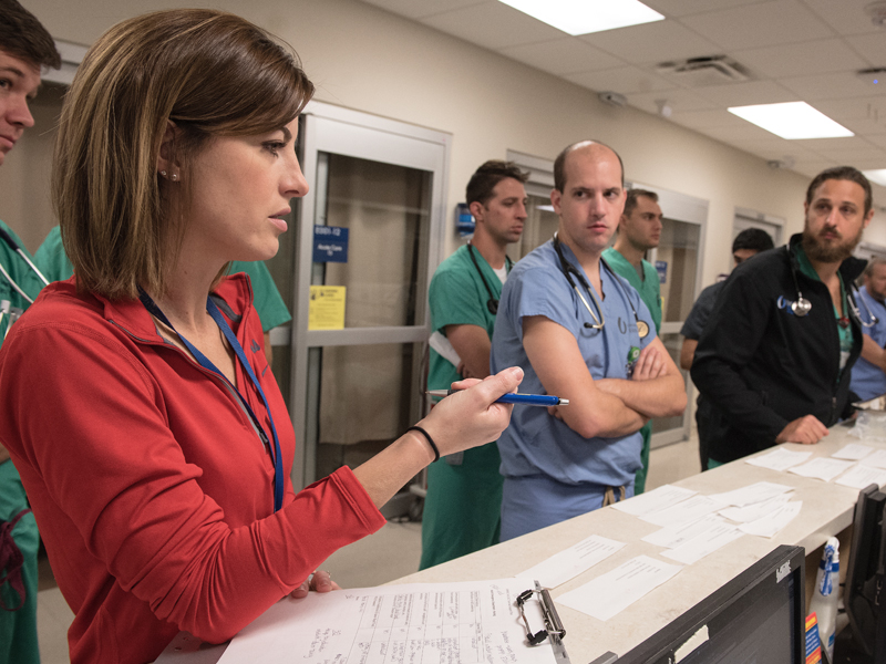 Rebecca Benson, a nurse manager in the Adult ED, gives instruction on patient care to nurses and residents as part of a mass casualty drill.