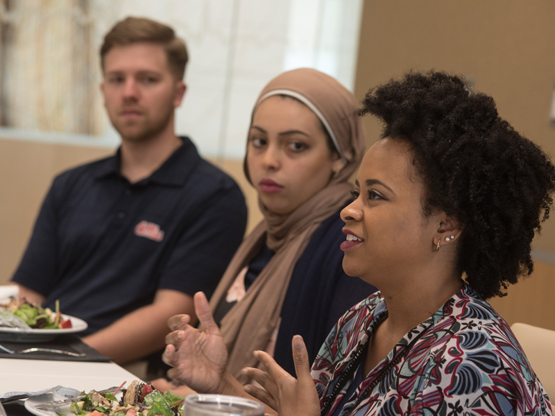 Acosta took time to lunch with students from the Associated Student Body diversity committee. From the right are medical students Kandice Bailey and Yassmin Hegazy and nursing student William Thomas.