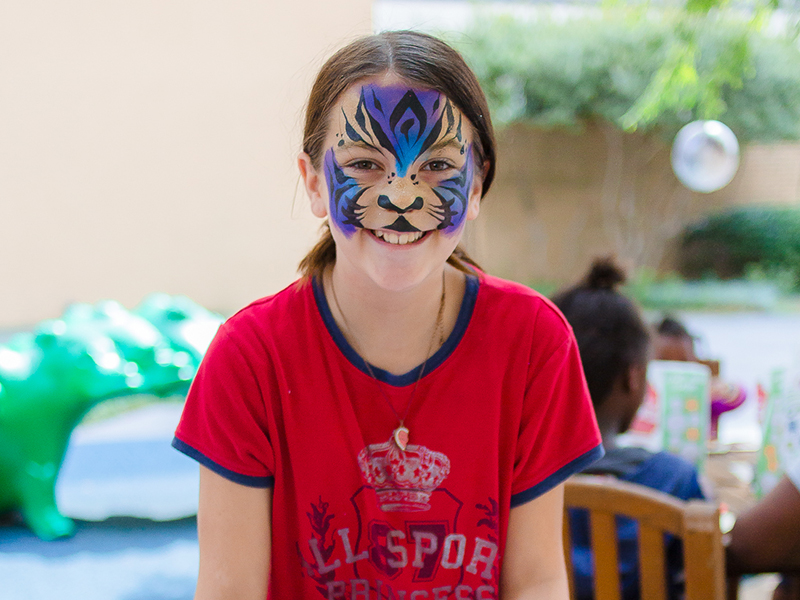 Madisyn Cockrell of Tallulah, La., shows her face paint and art work during Mississippi Children's Museum Day at Batson Children's Hospital. Her sister is a patient at the hospital.