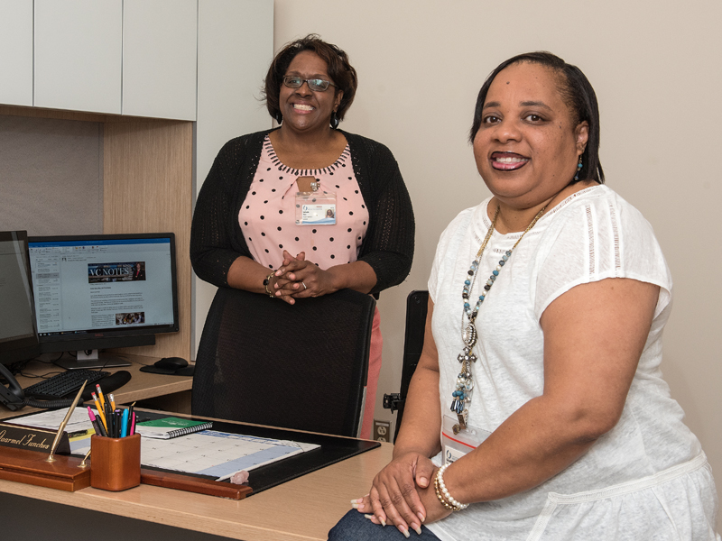 Dr. Gaarmel Funches, right, director of the Office of Health Careers Opportunity, and LaFreda Sias, OHCO project manager, work together to recruit public and private school students for the office's many pipeline and enrichment programs.