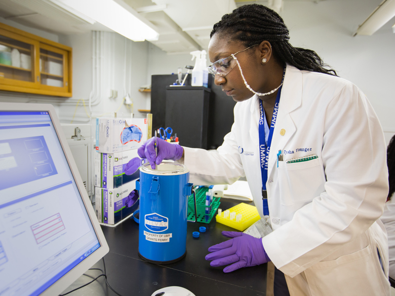 Tyesha Younger, a biorepository specialist, checks super-chilled samples in UMMC's biobank.