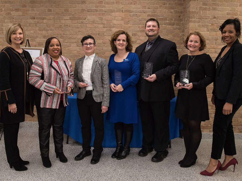 Pillars award winners honored by Dr. LouAnn Woodward, left, and Dr. Juanyce Taylor, right, include, from left, Dr. Gaarmel Funches, Dr. Norma Ojeda, Rev. Jill Barnes Buckley, Brent Necaise and Dr. Barbara Craft.