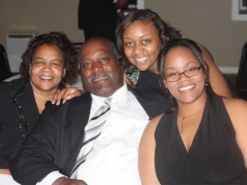 Moore, right, savors a moment with her family, from left: mom Hazel Pittman, dad Lynn Pittman and sister Roshanda Deboise.
