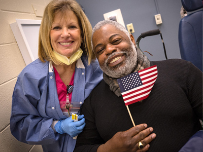 Donna Edwards, dental assistant, and Curtis Porter, U.S. Army veteran, are all smiles after his dental visit Thursday.