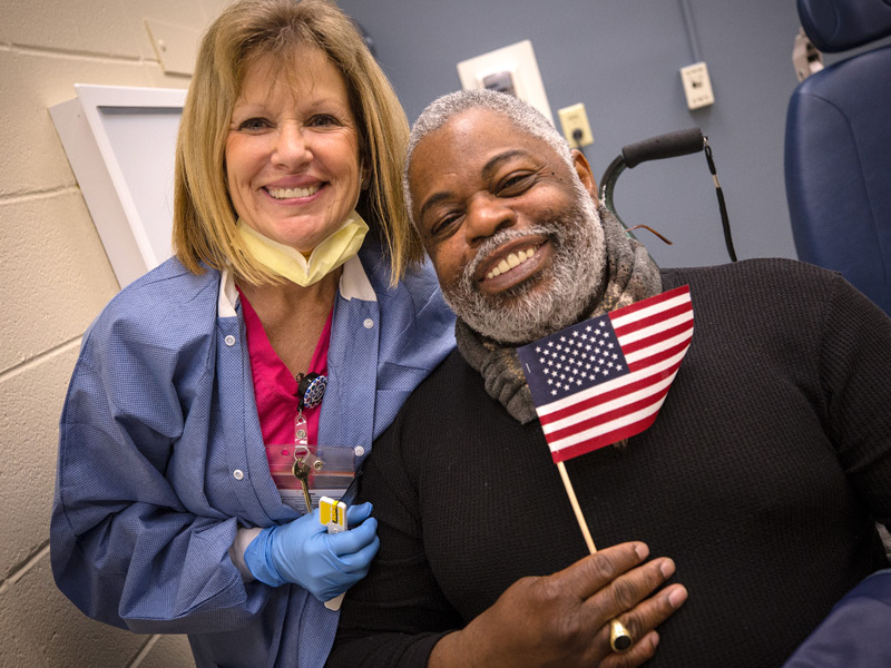 Donna Edwards, dental assistant, and Curtis Porter, U.S. Army veteran, are all smiles after his dental visit at the 2018 Dental Mission Week hosted by the School of Dentistry at the University of Mississippi Medical Center.