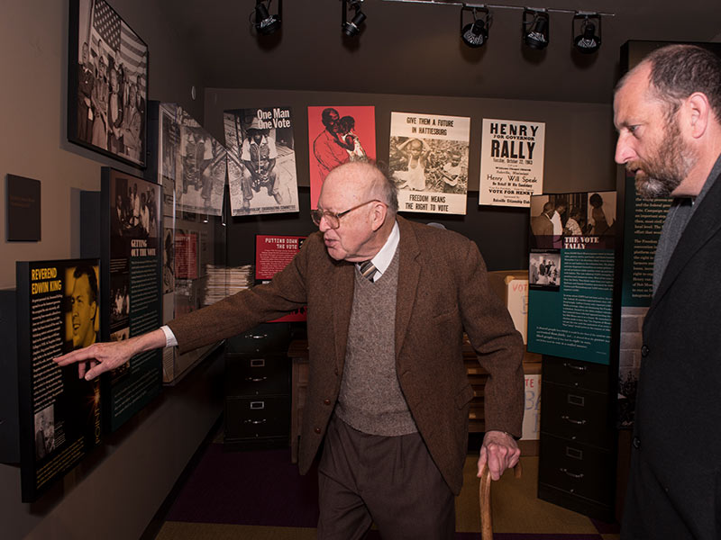 Touring the Mississippi Civil Rights Museum with Chris Goodwin, right, director of public information for the Department of Archives and History, the King points out his former wife's name in an exhibit describing his work in the movement.