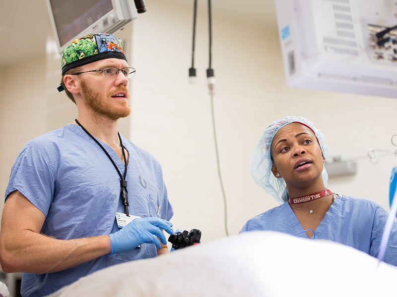 Dr. Jacob Moremen prepares to insert an esophageal scope as part of the POEM procedure while Angela Sloan, scrub tech, assists.